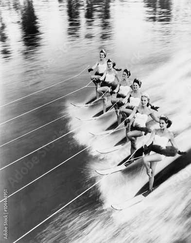 Row of women water skiing  - 104444951