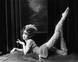 Bored dancer posing in beaded costume  - 104445304