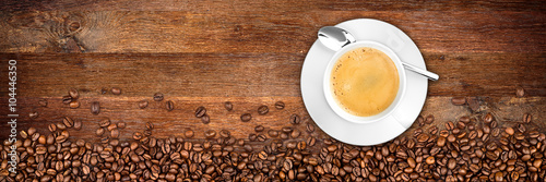 coffee background with beans and cup on rustic old oak wood © stockphoto-graf