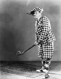 Man in a checkered golf outfit  - 104446976