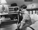 Boy listening to radio in bedroom  - 104448123