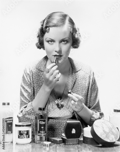 Woman applying cosmetics  - 104450180