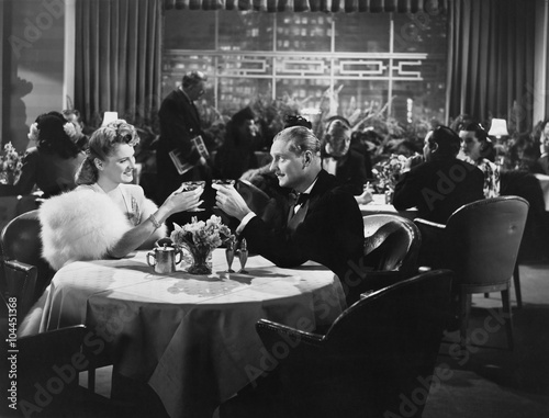 Couple dining in crowded restaurant  - 104451368
