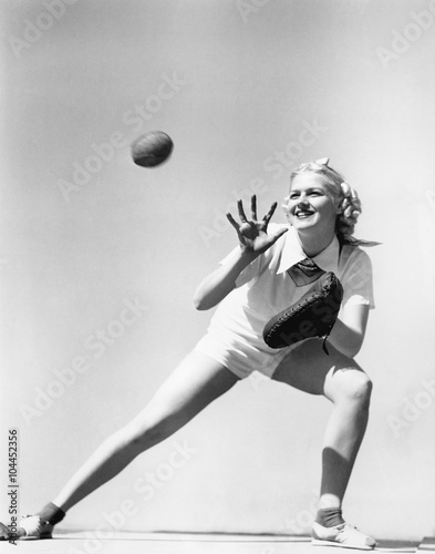 Woman catching a baseball  - 104452356