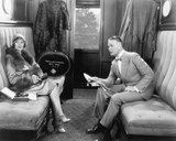 Couple sitting together in a compartment of a train  - 104452785