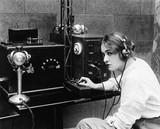 Woman sending Morse code using telegraph  - 104453505