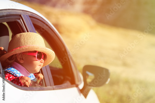 obraz PCV cute little girl travel by car in mountains