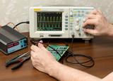 Workplace engineer. Oscilloscope.
