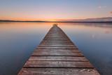 Old wooden pier on sunset