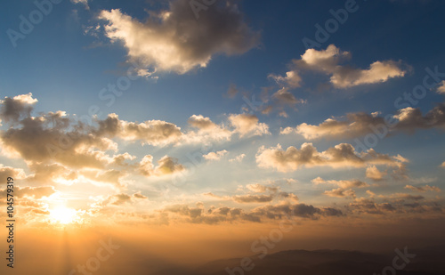 colorful dramatic sky with cloud at sunset - 104579319