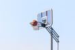 ball into the basketball hoop on the street