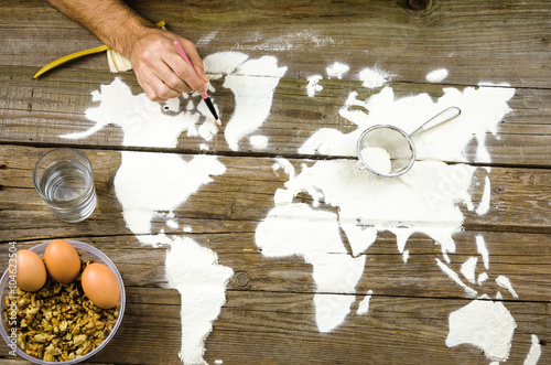 Drawing maps of the world with flour Poster
