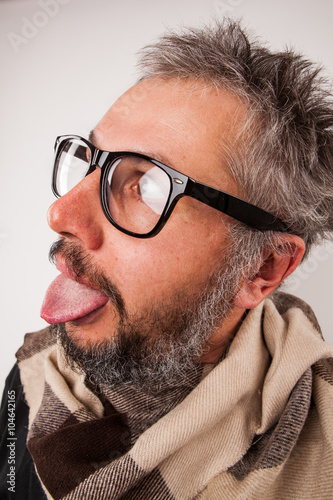 Crazy looking old man with grey beard with nerd big glasses show tongue rolling Poster