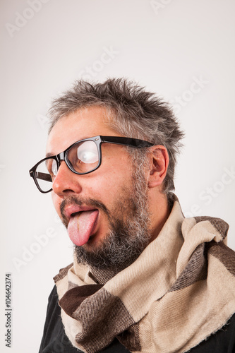 Poster Crazy looking old man with grey beard with nerd big glasses show tongue rolling