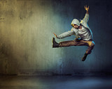 Fototapety Athletic dancer in a jumping pose