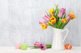 Fototapety Easter eggs and colorful tulips bouquet