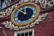 Boston, Massachusetts - July 13, 2013:   A handsome clock adorns the facade of the historic 1713 Old State House at the corner of State and Washington Streets is a landmark site on the Freedom Trail