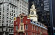 Boston, Massacusetts - July 13, 2013:  The historic 1713 Old State House at the corner of State and Washington Streets is a landmark site on the Freedom Trail