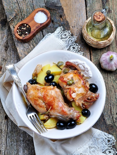 obraz PCV Roast rabbit in white wine with rosemary, olives and capers