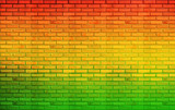 Fototapety green red yellow brick Wall background Reggae style