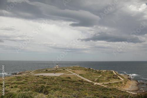 Faro en la costa Poster