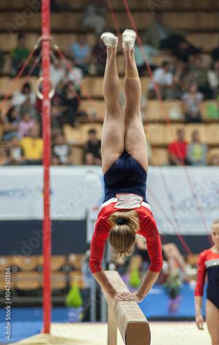 Спортивная гимнастика, прыжок на бревне. Poster