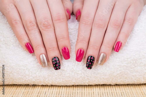 Manicure. Close up shot of nail art and hands care. © tamara83