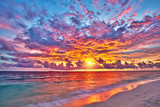 Colorful sunset over ocean on Maldives - 104787586