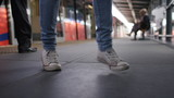 Happy feet of somebody dancing on a train platform