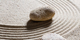 zen sand still-life - textured stones set on sinuous waves for concept of flexibility or suppleness with inner peace