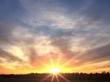 Bright orange sunrise on the horizon - 104802798