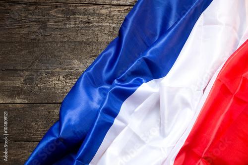 Frankreich Flagge auf Holztisch Poster