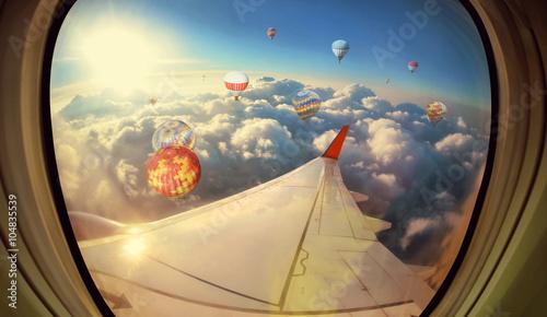 Fototapeta Clouds ,sky and Balloons as seen through window of an aircraft