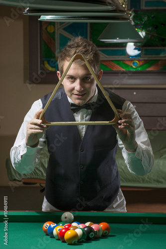 handsome man smiling in billiard club
