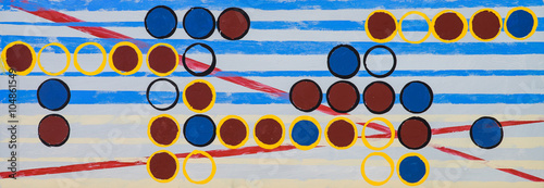 A long thin grid painting with blue and yellow striped background - 104861549