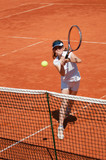 Tennis volley on the net, junior level player