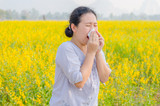Asian woman has allergy at flower field