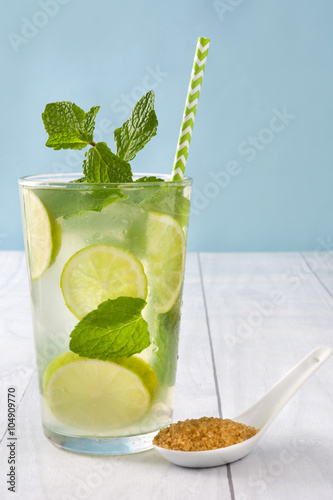 Plakat Summer drink. Fresh mojito with lime and mint. Blue background