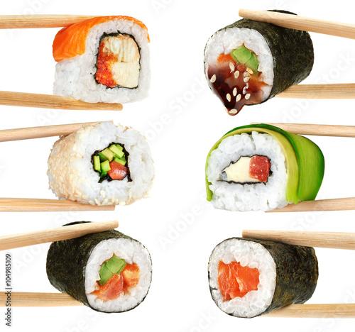 Fototapeta Sushi rolls isolated on white background. Chopsticks.