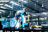 Welding robot in production plant or factory - 105007543