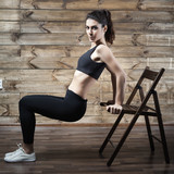 Workout exercises at home to lose weight. Woman training.