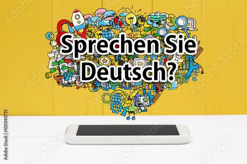 Naklejka Sprechen Sie Deutsch concept with smartphone