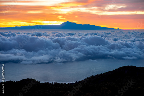 Poster Oranje eclat Beautiful cloudscape with Tenerife island on background on the sunrise in Spain