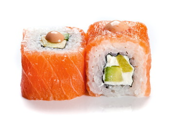 Sushi rolls with salmon close up isolated on white. Two philadelphia shushi rolls