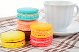 close up of colorful macarons and cup of coffee - 105153184