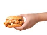 Hand holding chicken burger on white background - 105153340