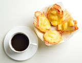 Pizza with ham and pineapple and cup of coffee - 105153916