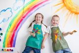 kids painting rainbow