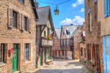 Narrow street with old traditional houses in Dinan