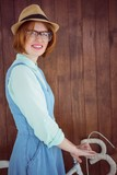 Cute red haired hipster with glasses and a bike
